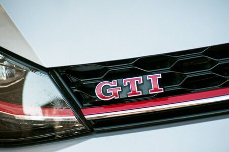Mulhouse - France - 17 September 2019 - Closeup of GTI sign on grey Volkswagen Golf GTI front parked in the street 報道画像