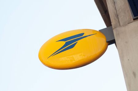 Mulhouse - France - 17 September 2019 - Closeup of french post logo on building facade Editoriali