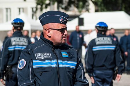 Mulhouse - France - 20 September 2019 -  Portrait of municipal policeman looking on the main place during  the Thirtieth anniversary ceremony of the creation of the municipal police