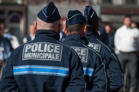 Mulhouse - France - 20 September 2019 -  Portrait of policemen standing on the main place during  the Thirtieth anniversary ceremony of the creation of the municipal police