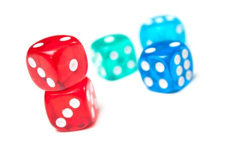 Closeup of colorful dices on white background Фото со стока