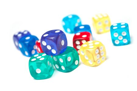 Closeup of colorful dices on white background