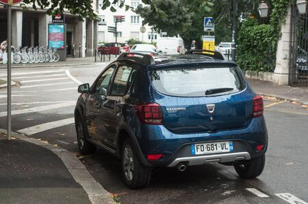 Mulhouse - France - 26 September 2019 - Rear view of blur Dacia Sandero crossover parked in the street