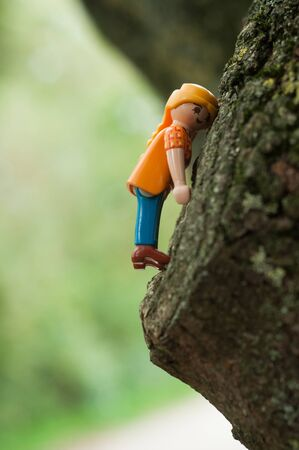 Mulhouse - France - 12 October 2019 - Closeup of Playmobil characters climbing  on tree trunk  in outdoor