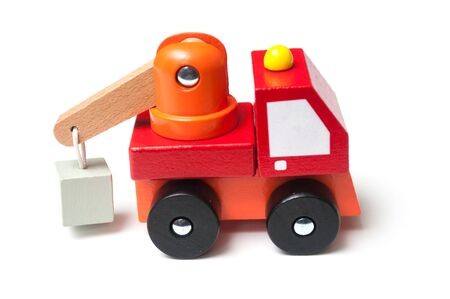 Closeup of miniature toy, wooden red truck with carrycot on white background Stock fotó - 132021652