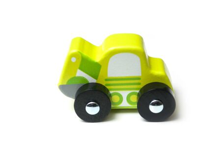 Closeup of miniature toy, wooden green car on white background Stock fotó - 132021576