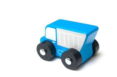 Closeup of miniature toy, wooden blue truck on white background