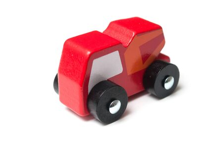 Closeup of miniature toy, wooden red truck on white background Stock fotó