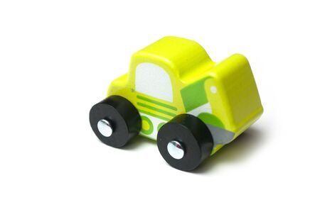 Closeup of miniature toy, wooden green car on white background Stock fotó