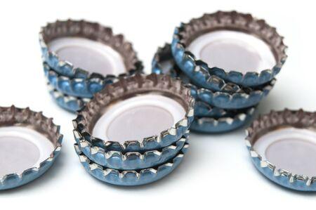 Closeup of metallic caps on white background
