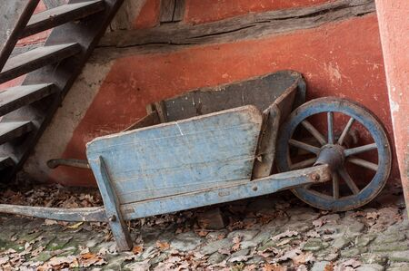 Closeup of vintage wooden whellbarrow in the historic village