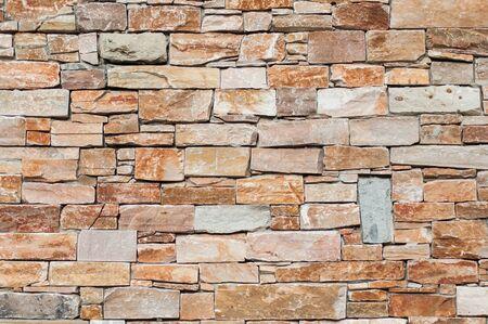 Nahaufnahme der dekorativen steinigen Wandbeschaffenheit Standard-Bild