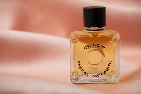 Mulhouse - France - 13 November 2019 - Closeup of Pascal Morabito perfume in a miniature bottle on satin background