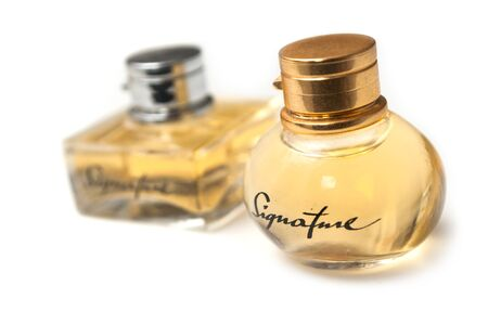 Mulhouse - France - 19 November 2019 - Closeup of signature perfume in a transparent bottle on white background