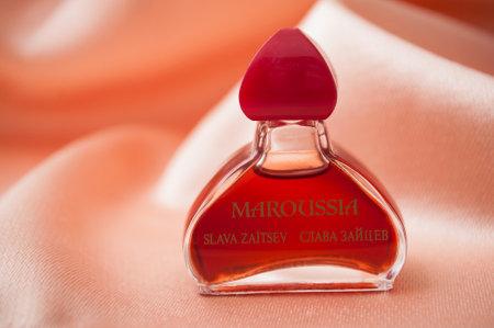 Mulhouse - France - 15 November 2019 - Closeup of Maroussia perfume in miniature bottle on satin background Sajtókép