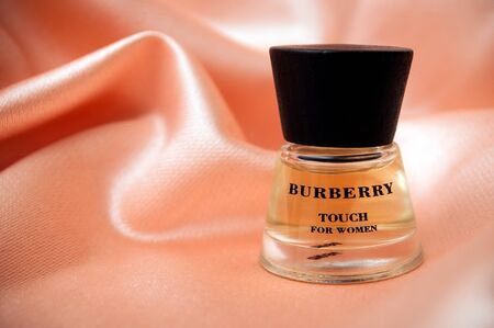 Mulhouse - France - 13 November 2019 - Closeup of Burberry perfume in a transparent bottle on satin background
