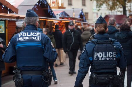 Mulhouse - France - 23 November 2019 - police patrol in the pedestrian street at the christmas market