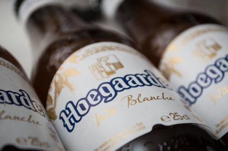 Mulhouse - France - 25 November 2019 - Closeup of the famous belgian Hoegaarden bottles of white bier on white background