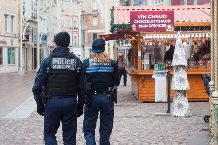 Mulhouse - France - 1 December 2019 - police patrol in the pedestrian street at the christmas market