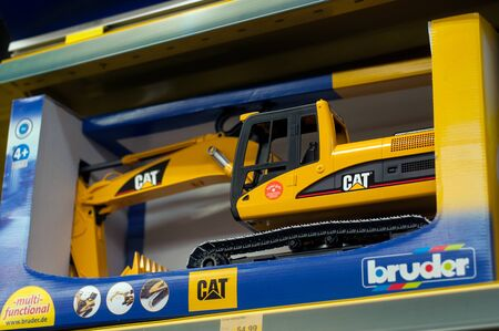 Mulhouse - France - 7 December 2019 - Closeup of catterpillar buldozer toy for dale in a toys store supermarket Éditoriale