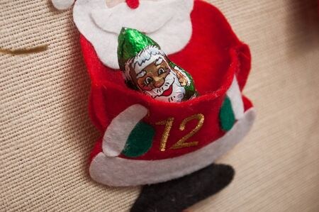 Closeup of chocolate in shaped santa claus on advent calendar