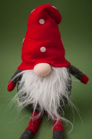 Closeup of christmas gnome on green background  Stock Photo
