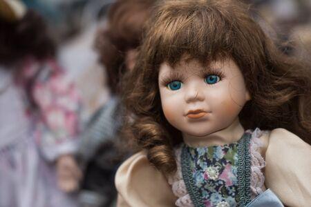 Closeup of vintage dolls at flea market in the street
