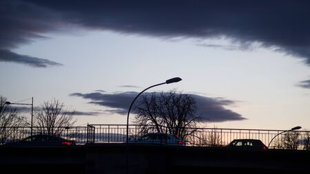 view of traffic of cars  silhouettes on the bridge silhouette and street light by sunset Stockfoto