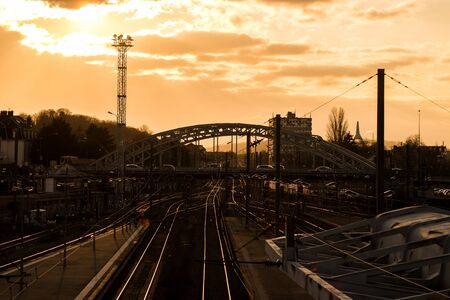 View of cityscape of Mulhouse in France with railways and bridge silhouette by sunset Zdjęcie Seryjne