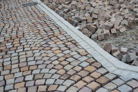 Closeup of geometric cobblestone construction site in the street