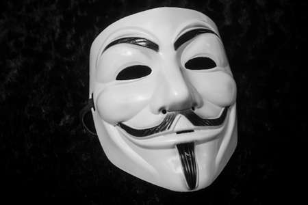 Mulhouse - France - 8 May 2020 - Closeup of Vendetta mask on black background. This mask is a well-known symbol for the online hacktivist group Anonymous