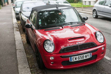 Mulhouse - France - 14 June 2020 - Front view of red mini cooper S parked in the street