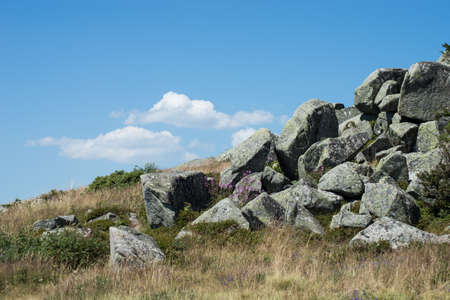 View of megaliths at the top of the mountain on blue sky background