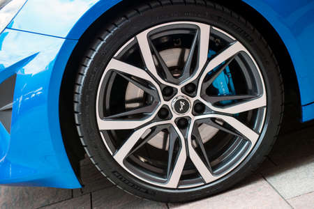 Mulhouse - France - 21 August 2020 - Closeup of wheel of blue Renault Alpine A110 parked in he street