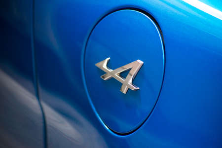 Mulhouse - France - 21 August 2020 - closeup of logo on blue Renault Alpine A110 parked in he street