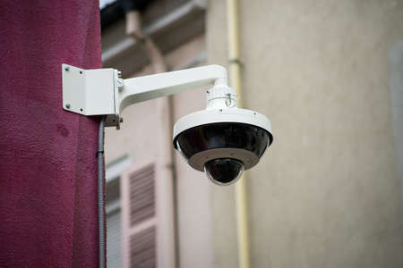 Closeup of security camera on stoned wal in the street Stock Photo
