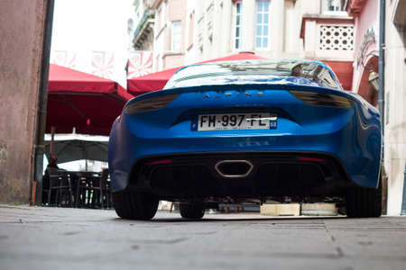 Mulhouse - France - 21 August 2020 - rear view of blue Renault Alpine A110 parked in he street