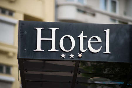 Closeup of hotel sign on building facade in the street