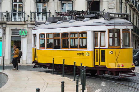 Lisbon - Portugal - 30 September 2020 - view of the famous vintage tramway parked in the street