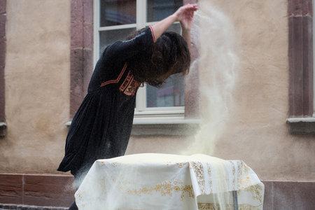 Mulhouse - France - 18 October 2020 - Portrait of Nenna as Morgan Audoin making msemens at the street scene festival