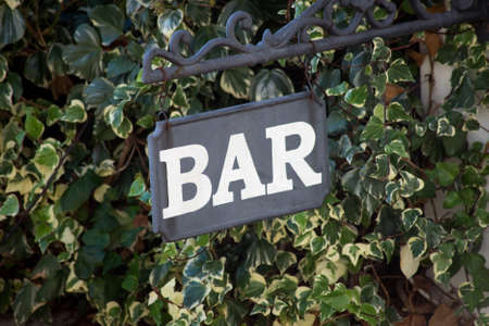 Closeup of BAR signage on green leaves background