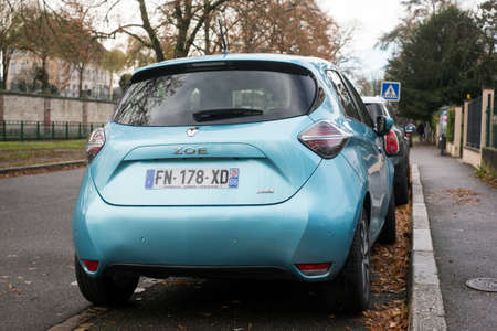 Mulhouse - France - 5 December 2020 - Rear view of blue Renault Zoe parked in the street