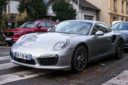 Mulhouse - France - 5 December 2020 - Front view of grey Porsche 911 parked in the street