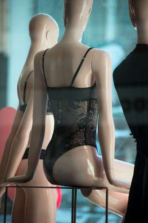 Closeup of black underwear on mannequin in a fashion store showroom