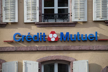 Ribauville - France - 18 Februaary 2021 - Closeup of Credit mutuel sign on bank agency facade in the street