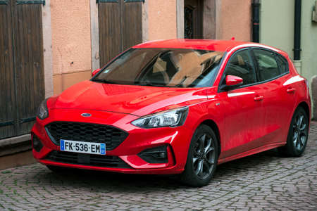 Ribauville - France - 18 February 2021 - Front view of red Ford Focus parked in the street