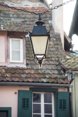 Closeup of retro street light in a typical french alsatian village Closeup of retro street light in a typical french alsatian village