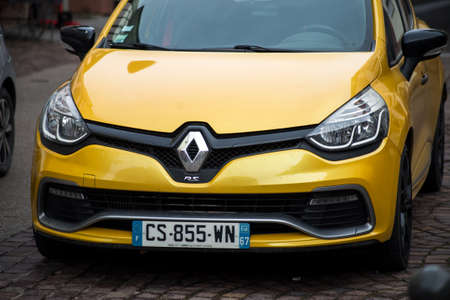 Ribauville - France - 18 February 2021 - Front view of yellow Renault Clio RS car parked in the street Redactioneel