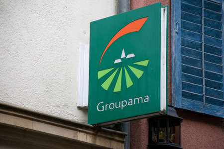 Ribauville - France - 18 February 2021 - Closeup of Groupama insurance sign on agency facade in the street Redactioneel