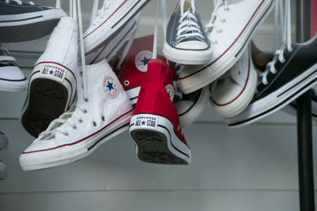 Mulhouse - France - 21 February 2021 - Closeup of vintage sneakers collection by Converse in a fashion store showroom